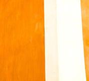 在欧洲意大利老墙壁的桔子和古董contruction染黄 免版税库存照片