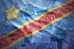 在欧洲背景的五颜六色的挥动的刚果民主共和国旗子 库存照片