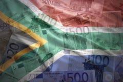 在欧洲背景的五颜六色的挥动的南非旗子 免版税库存图片