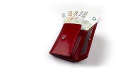 在正面边的捷克金钱在红色钱包里 免版税库存照片