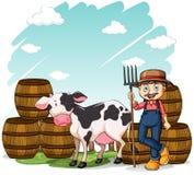 在母牛旁边的农夫 免版税库存图片