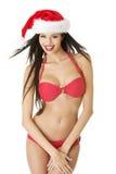 在比基尼泳装的性感的圣诞老人辅助工 库存照片