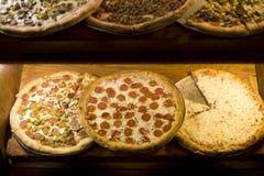 在比萨店的薄饼 免版税库存图片