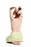 在毛巾包裹的妇女 免版税图库摄影