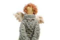 在毛线衣关闭的天使手工制造玩偶 免版税库存图片