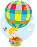 在气球的儿童飞行 图库摄影