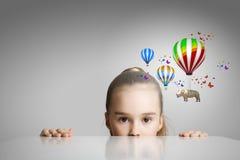 在气球的犀牛飞行 免版税库存图片