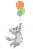 在气球的猫飞行 免版税库存照片