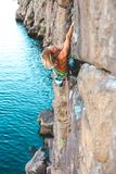 在水上的一个登山人 库存照片