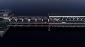 在水力发电站的空中飞行在道加瓦河在平衡的日落的里加 股票录像