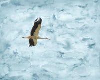 在水彩天空的鹳飞行 图库摄影