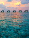 Villas on water, Maldives resort 免版税库存照片
