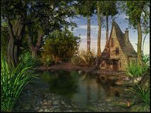 在池塘附近的老小屋 库存照片