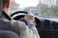在汽车乡下公路的司机 免版税库存照片