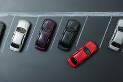 在汽车停车处的微型汽车 免版税图库摄影