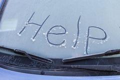 在汽车挡风玻璃的词帮助  库存图片