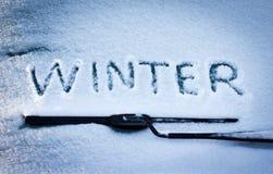 在汽车玻璃的字冬天 库存图片