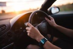 在汽车的乘驾 免版税库存图片