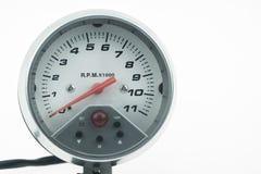 在汽车的车速表措施的速度 免版税库存照片