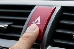 在汽车的紧急按钮 库存图片