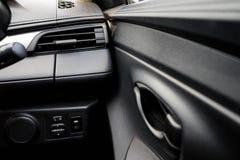 在汽车里面的仪表板 免版税库存照片