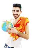 在沐浴的一个年轻男性给拿着地球穿衣 免版税库存照片