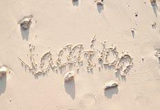 在沙子写的假期 库存图片