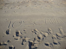 在沙子写的托斯卡纳 库存照片