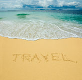 在沙子写的旅行 免版税库存照片