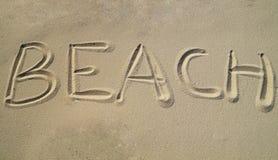 在沙子写的海滩 免版税图库摄影