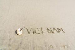 在沙子写的越南 免版税图库摄影