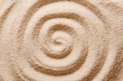 在沙子宏指令照片的螺旋 免版税库存图片