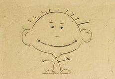 在沙子海滩的孩子动画片。 免版税库存照片