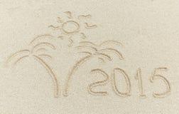 在沙子海滩的新年2015年消息 免版税库存图片