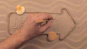 在沙子用手写的牙买加题字,在绳索做的尖 股票录像