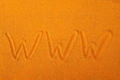 在沙子的万维网 库存图片