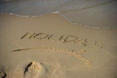 在沙子的假日消息 免版税库存图片