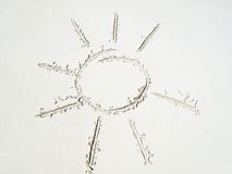 在沙子的太阳概述 免版税图库摄影