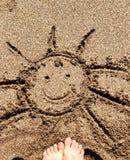 在沙子的太阳 免版税图库摄影