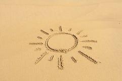 在沙子的太阳 库存图片