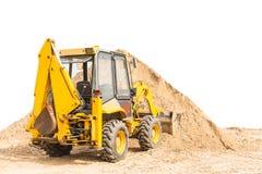 在沙子的拖拉机 库存照片