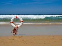 在沙子的救生员设备在海滩 免版税图库摄影