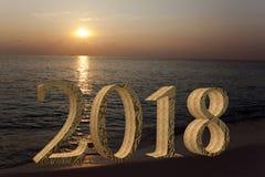 在沙子的新年题字2018年在海滩 图库摄影