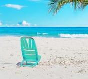 在沙子的椅子 库存照片
