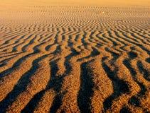 在沙子的模式 库存照片