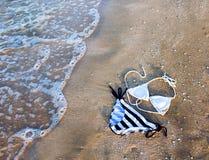 在沙子的泳装 库存图片