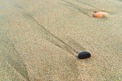 在沙子的海小卵石,海沙,岸沙子,上色了沙子 库存图片