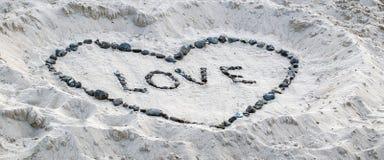 在沙子的爱证明 免版税库存图片