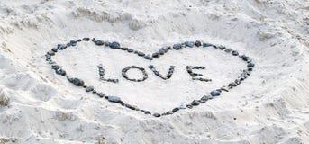 在沙子的爱证明 免版税图库摄影