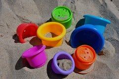 在沙子的玩具 图库摄影